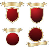Empty shields collection. Empty red shields collection, isolated objects over white Royalty Free Stock Photography