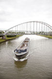 Empty ship in canal in holland Royalty Free Stock Photos