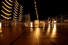 Empty ship deck with beach chairs and lamps Stock Image