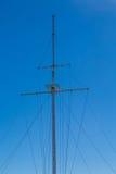 Empty Ships Mast on Blue Royalty Free Stock Photo