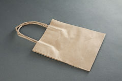 Empty Shopping Bag from craft paper Stock Photo