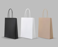 Empty Shopping Bags Set. White,Brown,Black,Cardboard. Set for advertising and branding. MockUp Package. Royalty Free Stock Images