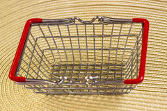 Empty shopping basket on a woven cloth Stock Photo