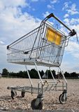 Empty shopping cart. On empty parking lot stock photography