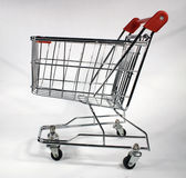 Empty shopping cart. View of an empty shopping cart on a white background. also known as a trolley Royalty Free Stock Image