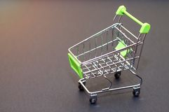 Empty shopping cart on a black background. The concept of shoppi. Ng in the supermarket Royalty Free Stock Images