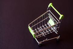 Empty shopping cart on a black background. The concept of shoppi. Ng in the supermarket Royalty Free Stock Image