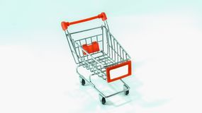 Empty Shopping Cart with Blank  on White Background. Empty Shopping Cart on White Background Stock Photography