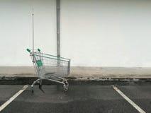 Empty green shopping cart royalty free stock photo