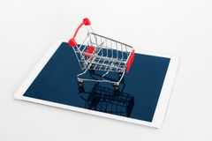 Empty shopping cart on digital tablet, on white background. Online shopping stock photography