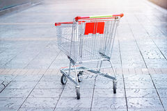 Empty shopping cart on the floor background. Empty shopping cart on the mosaic floor background Stock Image