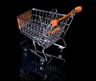 Empty Shopping Cart isolated in black. Empty Orange Shopping Cart isolated in black from top view Royalty Free Stock Photography