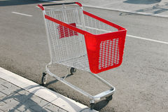 Empty shopping cart. Left outside by the customer of the store Royalty Free Stock Images
