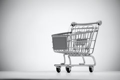 Empty shopping cart on light background. Stock Photo