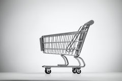 Empty shopping cart on light background. Stock Photography