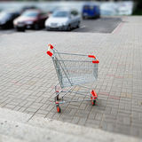 Empty shopping cart in parking. This photograph represents an empty shopping cart in parking lot Stock Images