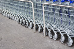 Empty Shopping Cart. In rank and file outside the supermarket Royalty Free Stock Image