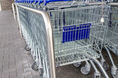 Empty Shopping Cart. In rank and file outside the supermarket Royalty Free Stock Photo
