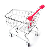 Empty shopping cart. With the red handle on a white isolated background Royalty Free Stock Photos