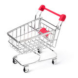 Empty shopping cart. With the red handle on a white isolated background Stock Image