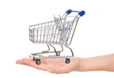 Empty shopping cart for sale on open hand Stock Photos