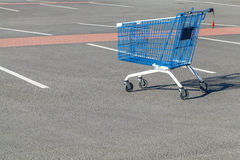 Empty shopping cart stands on a parking. Near supermarket Stock Images