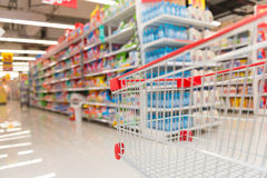 Empty shopping cart. In a supermarket Stock Images
