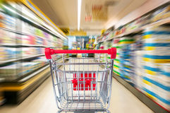 Empty shopping cart in supermarket. Motion blur Stock Photo