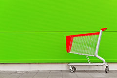 Empty Shopping Cart Trolley. In front of Shopping Mall with Blank Copy Space as Consumerism Concept Background Royalty Free Stock Photo