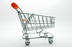 Empty shopping cart, trolley on white background Stock Photos