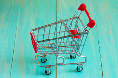 Empty  shopping cart on  the wooden surface Stock Images