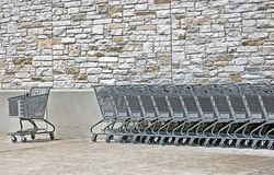 Empty Shopping Carts. Empty shppping carts outside a mall store Stock Photos