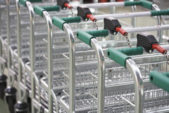 Empty Shopping Carts Linked Together Stock Photography