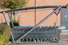 Empty shopping carts stacked together Stock Image