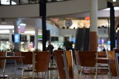 Empty shopping mall cafe. Focus on foreground, background blurred defocused Stock Image