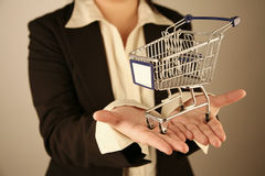 Empty shopping trolley. Hands holding empty shopping trolley Royalty Free Stock Photo