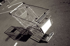 Empty shopping trolley. Empty metal shopping trolley or cart in car park outdoors Stock Photos