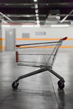 Empty shopping trolley in car park of supermarket. End of a tiring shopping day in supermarket Royalty Free Stock Photography