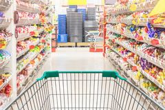 Empty shopping trolley cart in interior supermarket store stock photography