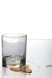 Empty Shot Glass. With spilled drink on the table Royalty Free Stock Images