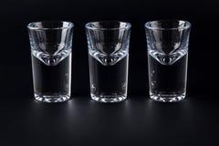Empty shot glasses on black background Royalty Free Stock Photo