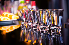 Empty shot glasses waiting on the bar  counter Stock Image