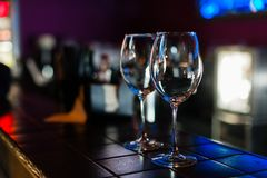 Empty wine glasses in row on bar or restaurant stock photos