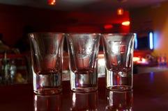 Empty shots in bar. Three empty shots in bar Royalty Free Stock Photography