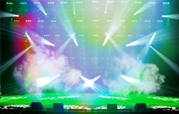 Empty show stage. Illuminated empty show stage with fog, green and blue scenic light and white rays royalty free stock images