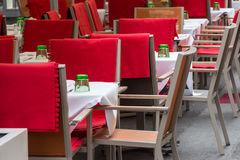 Empty sidewalk cafe with chairs Royalty Free Stock Images