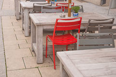 Empty sidewalk cafe with red chair Royalty Free Stock Image