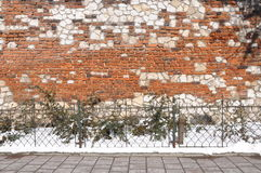 Empty sidewalk and wall in the background Stock Images