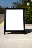 Empty Sign. Empty white sign board on sidewalk in the afternoon Royalty Free Stock Photo