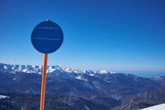 Empty  sign. Ski-track with Caucasus mountains on background. Ski vacation panorama on top of the mountain Royalty Free Stock Photos